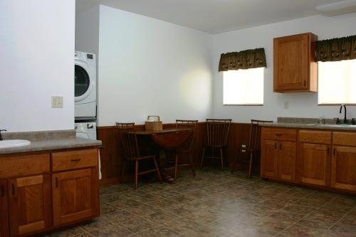 Photo of the kitchen and laundry area at Diane's House at Nature's Edge in Rice Lake, WI.